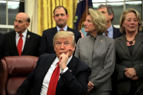 FILE PHOTO: President Trump attends a signing ceremony for the Interdict Act into law, to provide Customs and Border Protection agents with the latest screening technology on the fight against the opioid crisis, in the Oval Office of the White House, January 10, 2018. REUTERS/Carlos Barria
