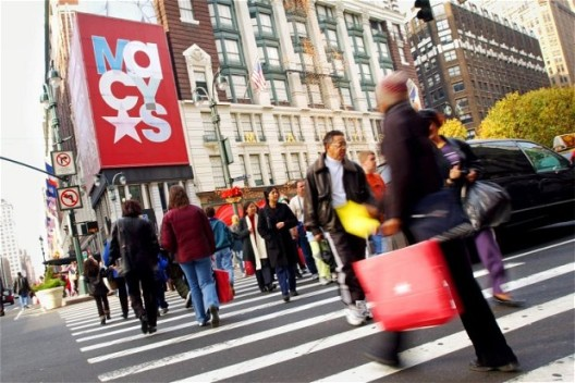 Christmas Shopping Season Kicks Off in New York City...397655 01: Shoppers make their way across Herald Square near Macy's department store November 23, 2001 in New York City. The Christmas shopping season started kicked off in the United States the day after Thanksgiving, one of the busiest shopping days of the year. (Photo by Chris Hondros/Getty Images)