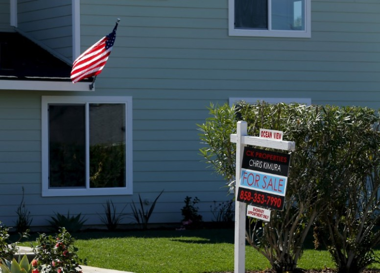 """FILE PHOTO: A """"For Sale"""" sign is seen outside a home in Cardiff, California February 22, 2016. REUTERS/Mike Blake/File Photo"""
