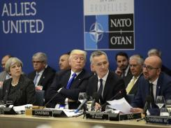 British Prime Minister Theresa May, U.S. President Trump and NATO Secretary-General Jens Stoltenberg listen to Belgian Prime Minister Charles Michel speak during a NATO summit in Brussels on May 25, 2017.