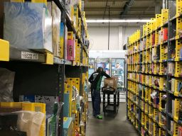 FILE PHOTO: An employee collects items ordered by Amazon.com customers through the company's two-hour delivery service Prime Now in a warehouse in San Francisco, California, U.S., December 20, 2017. REUTERS/Jeffrey Dastin/File Photo