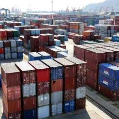 Shipping containers are seen at a port in Lianyungang