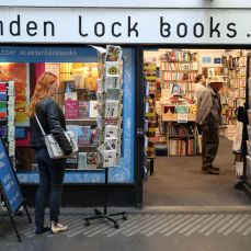 FILE PHOTO: A woman looks at gift cards outside Camden Lock Books shop, Old Street Station, London