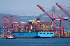 FILE PHOTO: A Maersk Line container ship prepares to depart port in Long Beach, California
