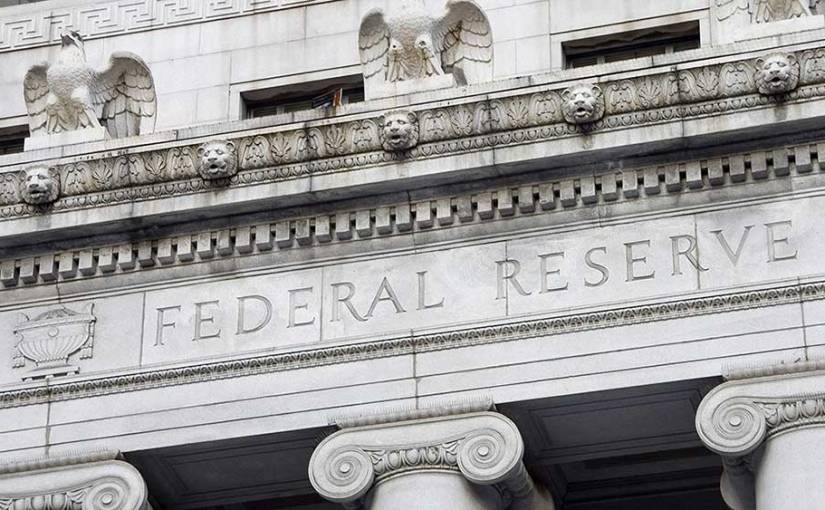 The Federal Reserve nudged up short-term interest rates for the fourth time this year, defying pressure from PresidentTrump.