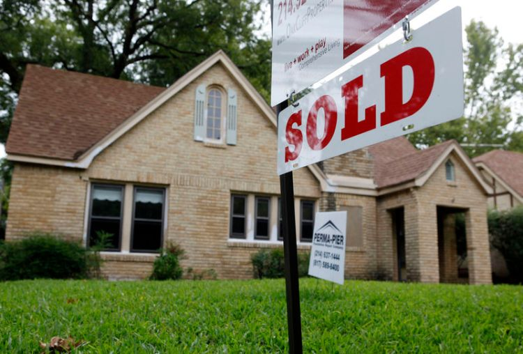 A sold sign hangs in front of a house in Dallas