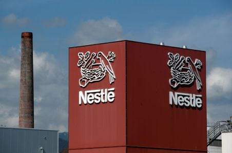 FILE PHOTO: A Nestle logo is pictured on a coffee factory in Orbe