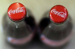 SAN FRANCISCO, CA - APRIL 16: Bottles of Coca Cola are displayed at a market on April 16, 2013 in San Francisco, California. Share prices of Coca Cola Co. surged as much as 5.8% today after the company reported better than expected first quarter profits. The stock surge is the largest intraday gain for Coca Cola since February 2009. (Photo by Justin Sullivan/Getty Images)